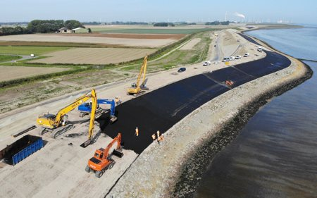 Paving of the sea levee with asphalt near Delfzijl, the Netherlands