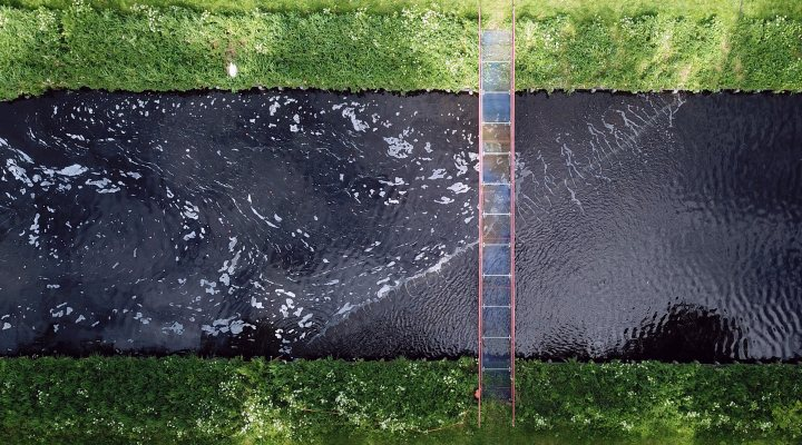 Aerial view of the bubble barrier placed diagonally in the effluent channel of wwtp Wevershoof