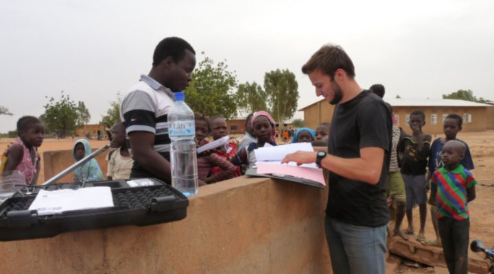 Water quality control at a water source in Burkina Faso